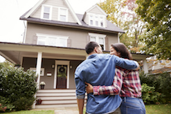 Image of happy couple buying a house